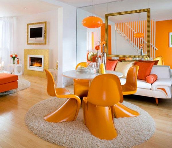 ميز و صندلي به رنگ نارنجي در اتاق نارنجي رنگ و تاثير آن در دکوراسیون داخلی