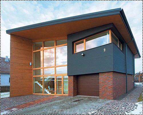 یک خانه با نمای ترمووود نمایش داده شده است
