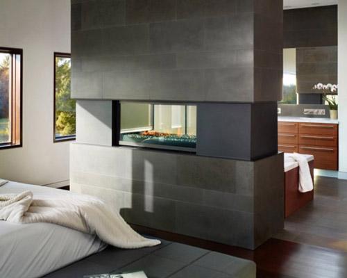تقسیم فضای اتاق خواب توسط شومینه مدرن