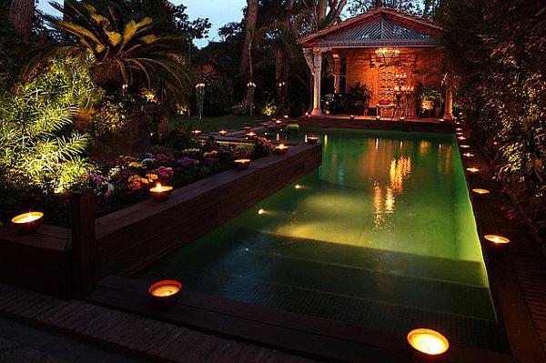 نورپردازی باغچه ای که استخر دارد با چراغ های ضد آب