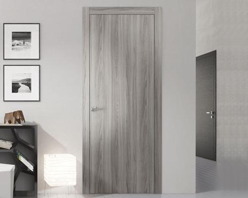 درب مسطح بدون برجستگی و پنل و ساخته شده از چوب ، از انواع درب داخلی ساختمان